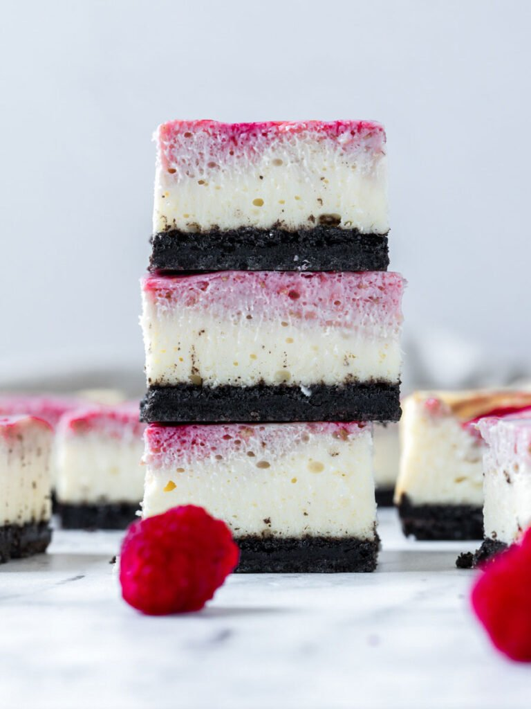 chocolate raspberry bars stacked up on one another