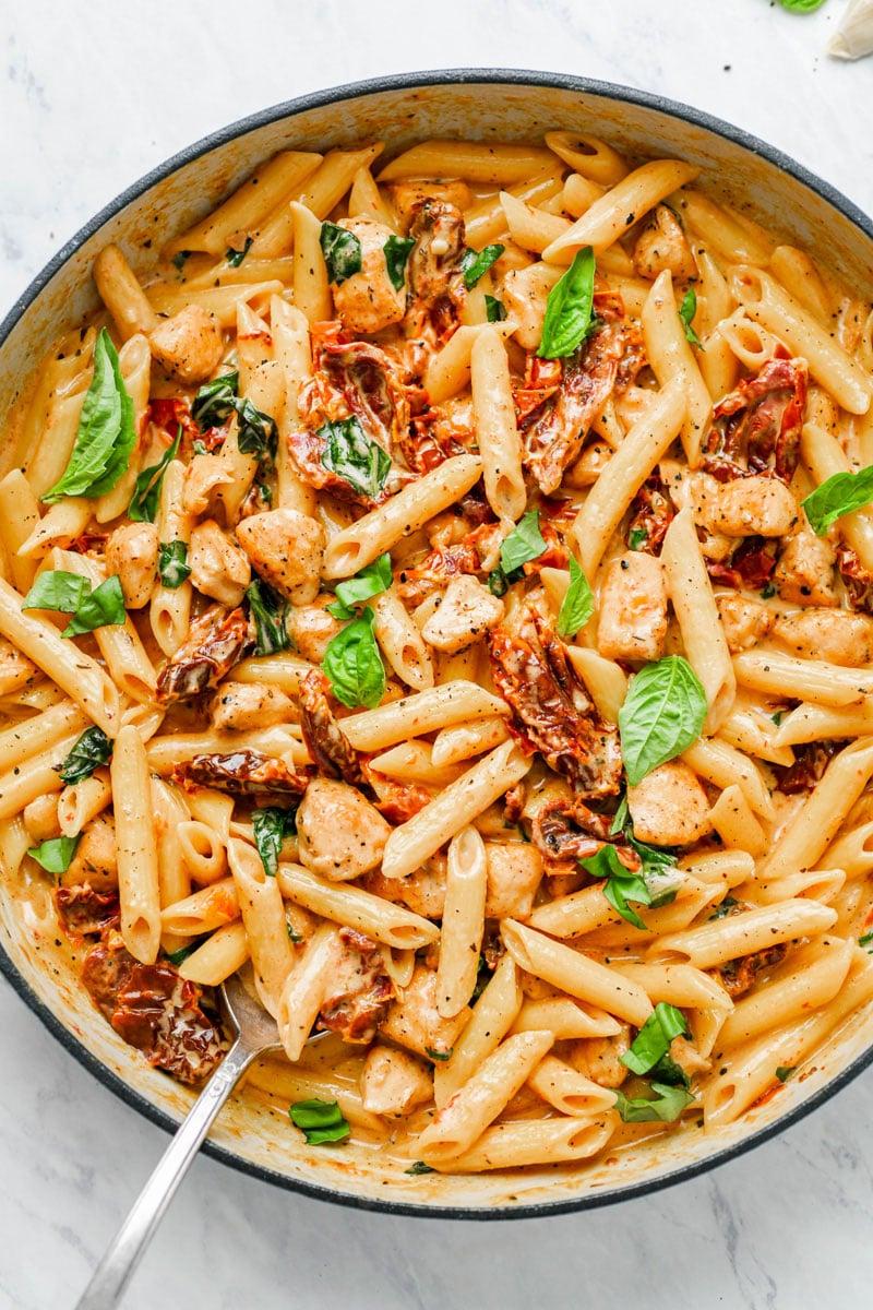 Creamy sun-dried tomato pasta in a pot.