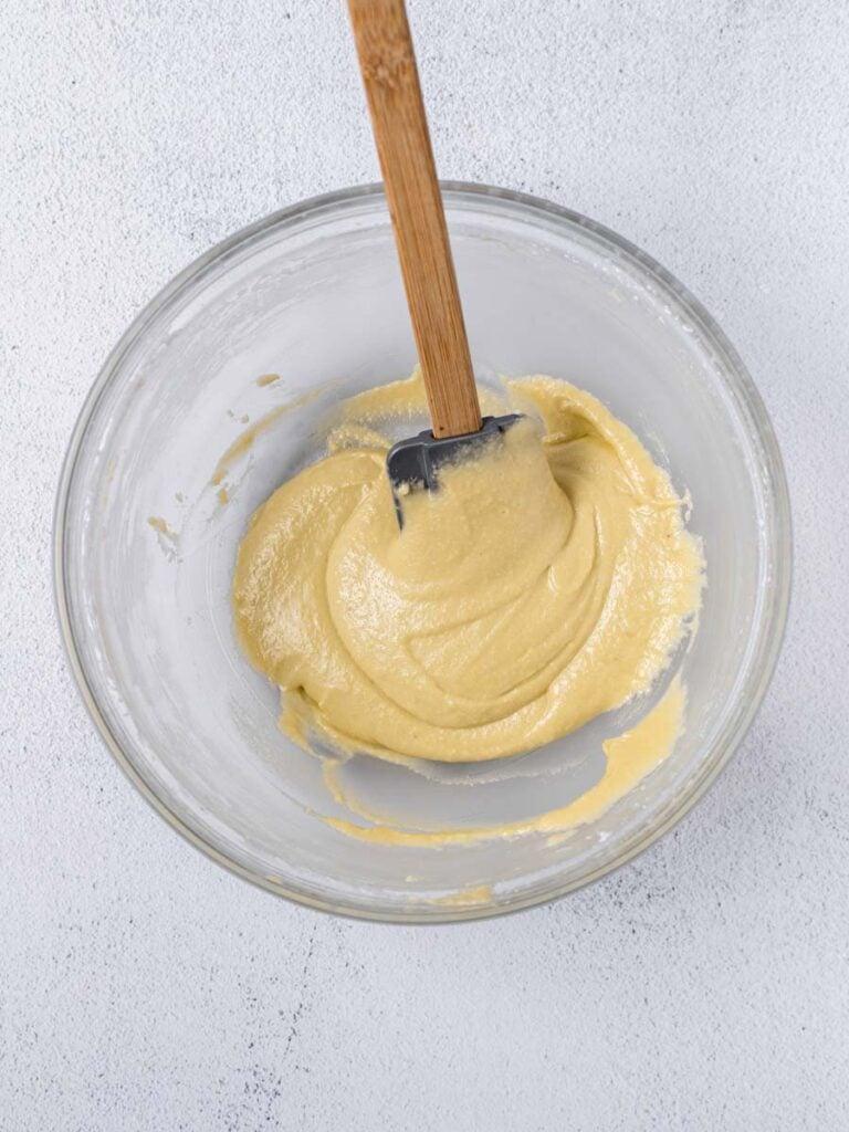 lemon macaron batter in a bowl