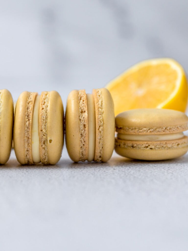 lemon macarons laid out next to each other