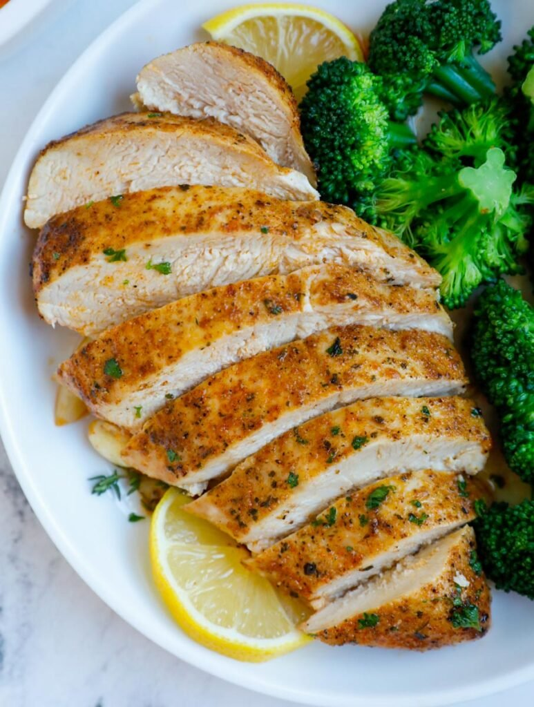 Sliced chicken breast on a plate.