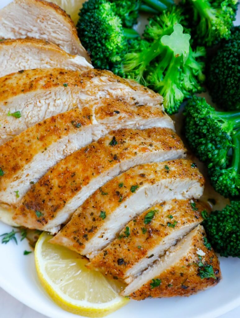 Close up of sliced baked chicken breasts.