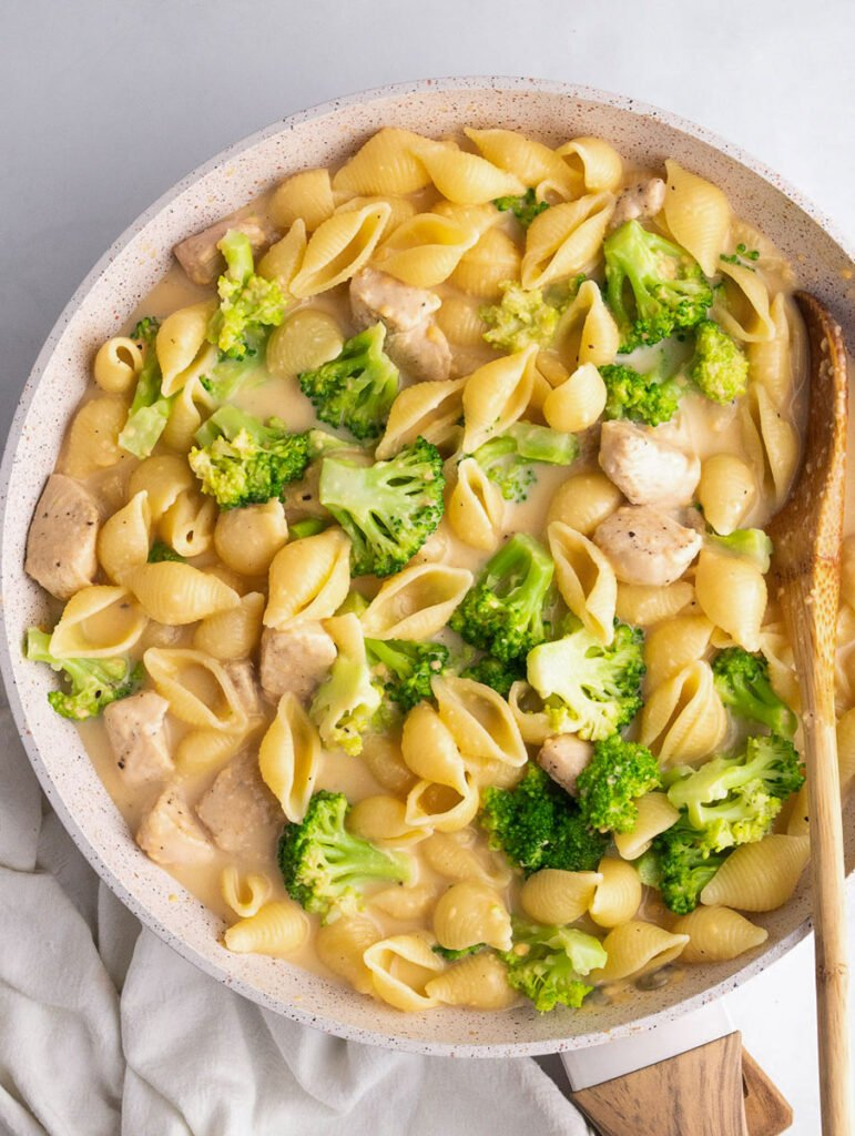 top down shot of the creamy broccoli chicken in a skillet