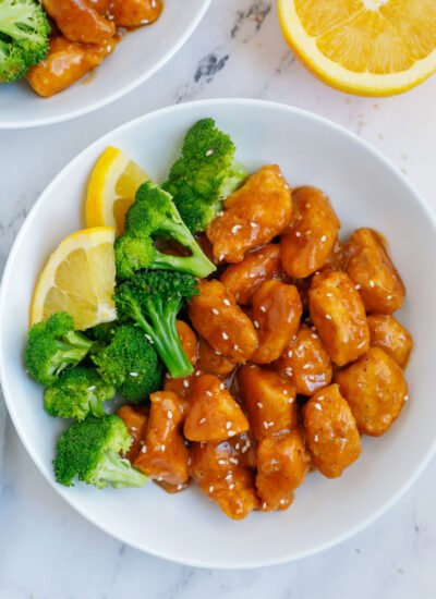 A plate of orange chicken with broccoli.