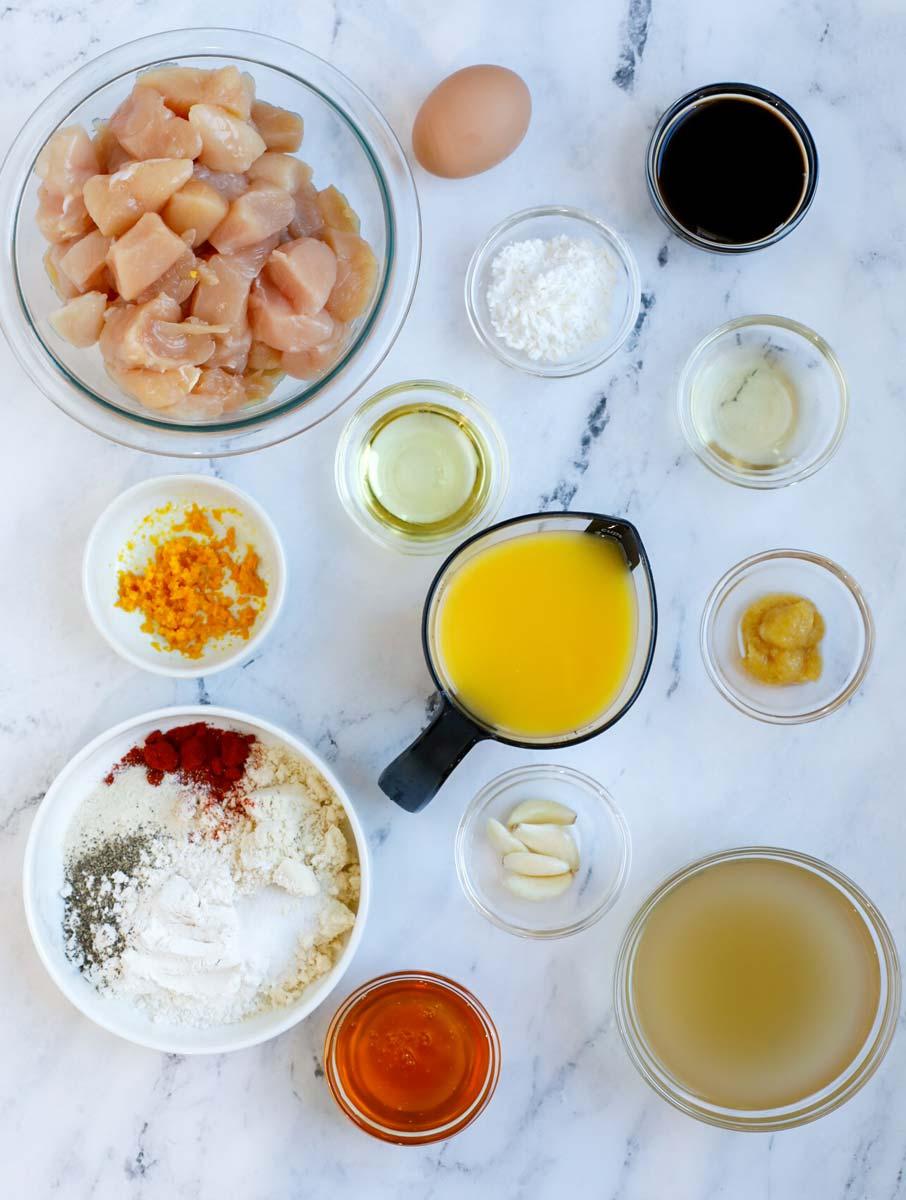 Overhead view of ingredients needed to make healthy orange chicken.