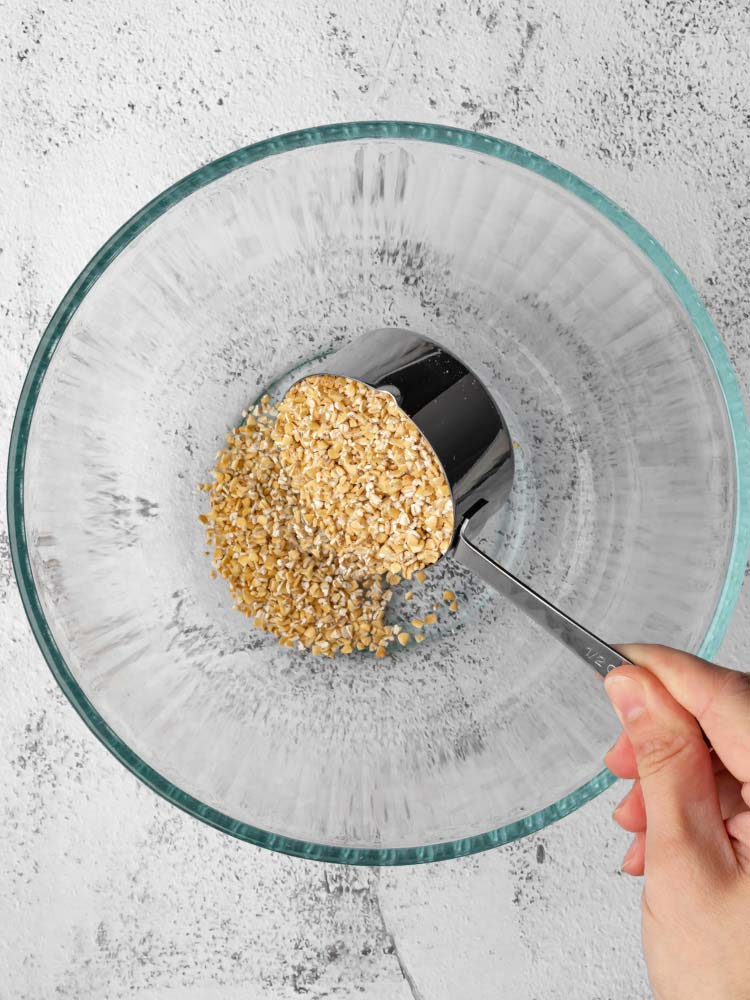 uncooked oatmeal bring poured into the bowl