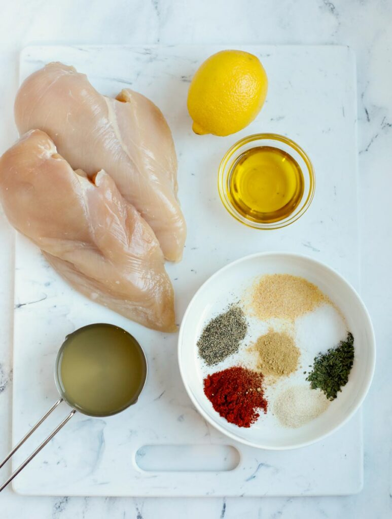 Overhead view of ingredients needed to make oven baked chicken breasts.