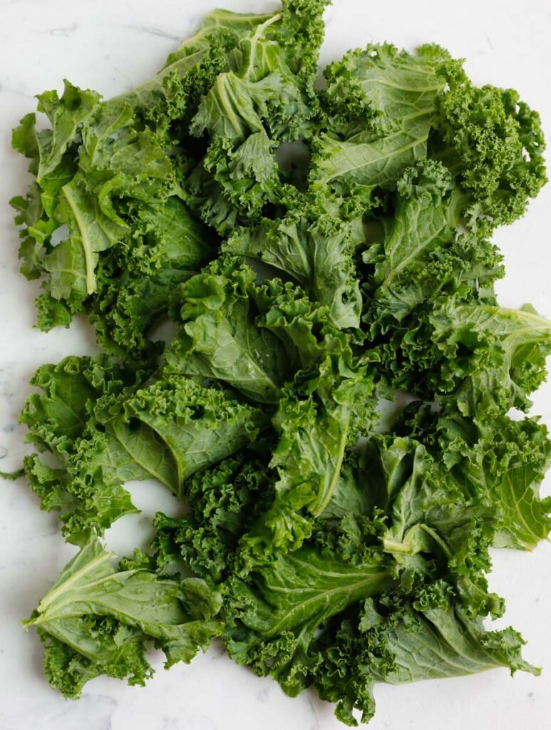Kale leaves ripped into smaller leaves.