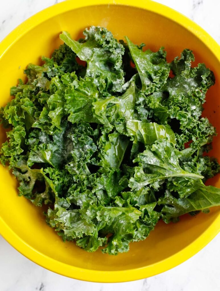 Kale leaves in a bowl to turn into chips.