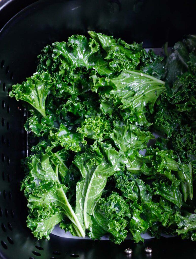 Kale leaves in an air fryer.