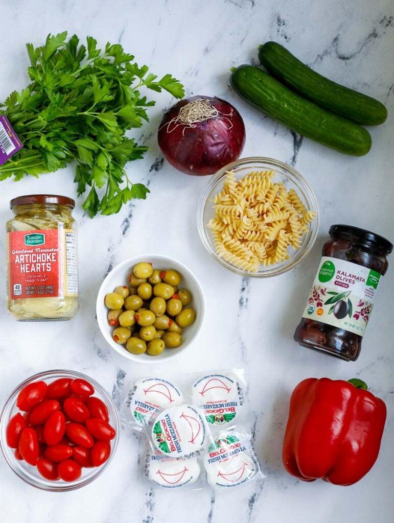 Ingredients for Mediterranean pasta salad.