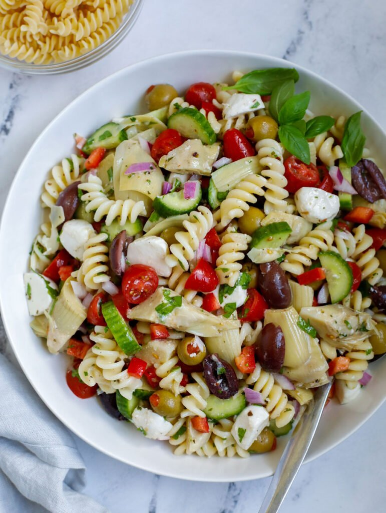 A Mediterranean pasta salad in a bowl.