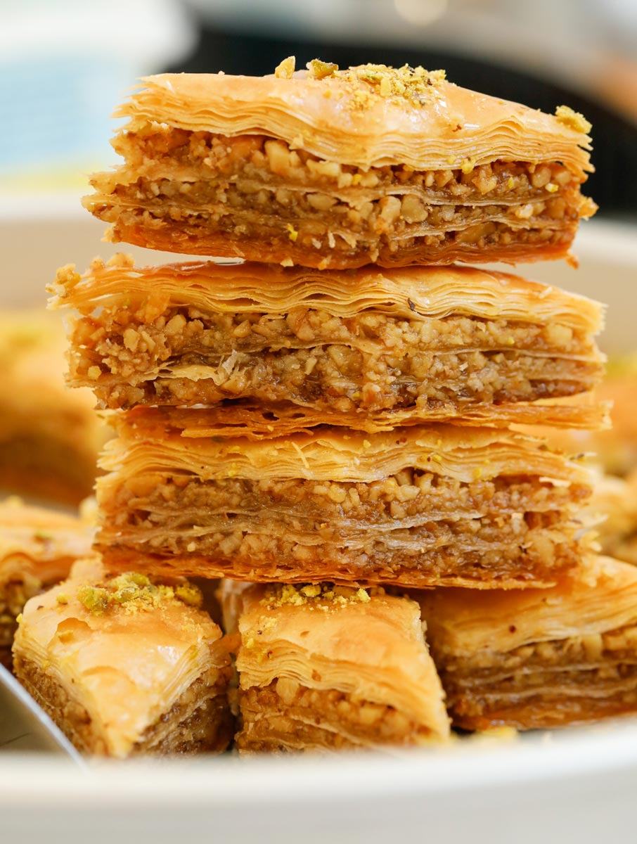 Multiple walnut baklava stacked on top of each other.