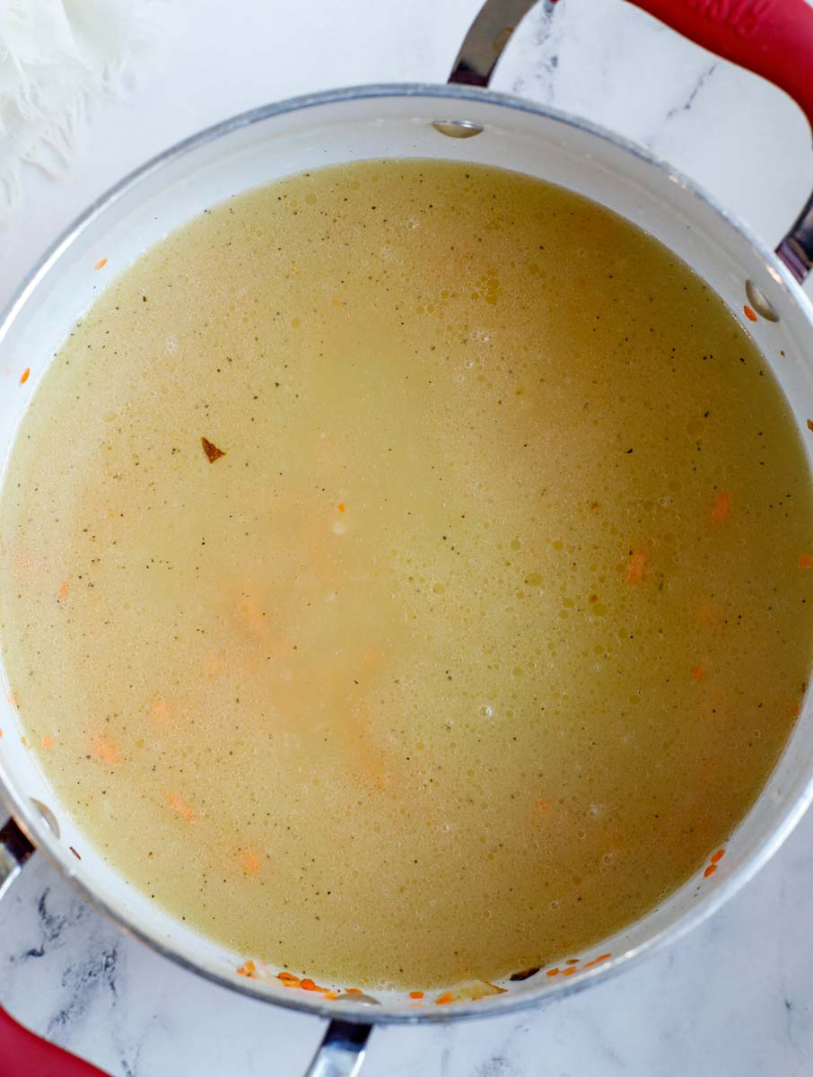 Pot with chicken broth, salt and water added to it.