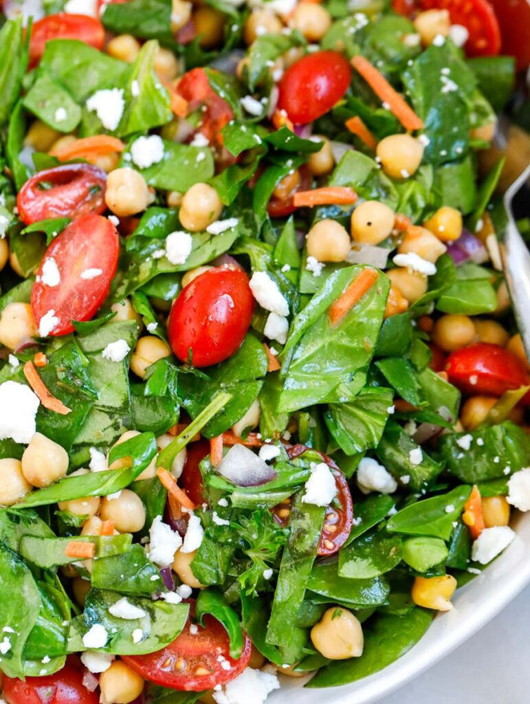 Close up of a chickpea spinach salad.