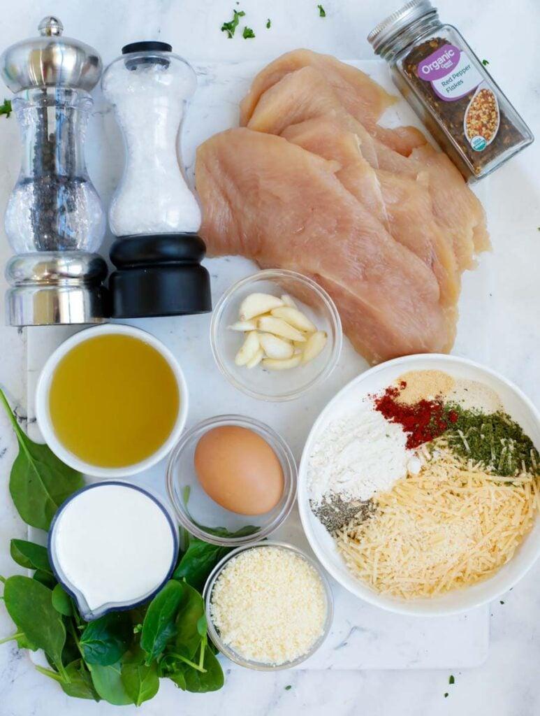 Ingredients needed to make creamy parmesan chicken.