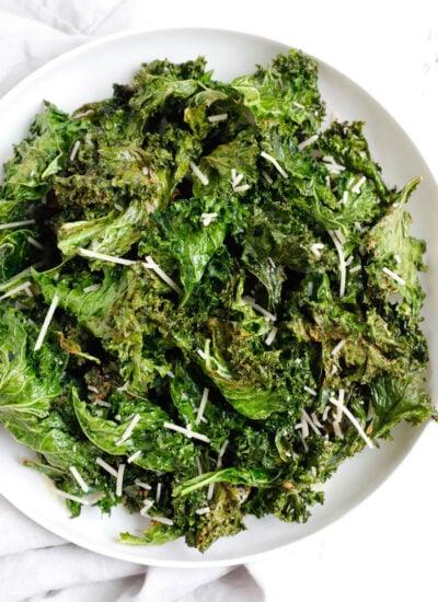 Crispy kale chips in a plate.