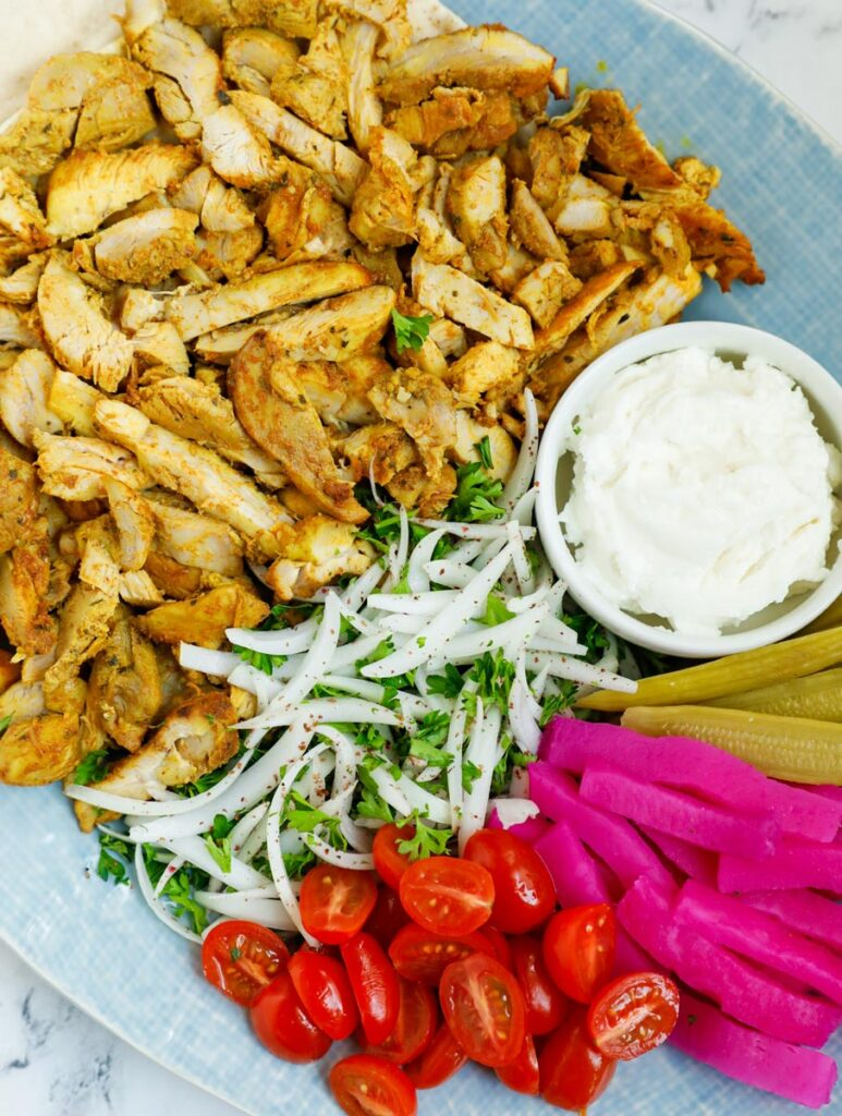Close up of a platter of chicken shawarma.