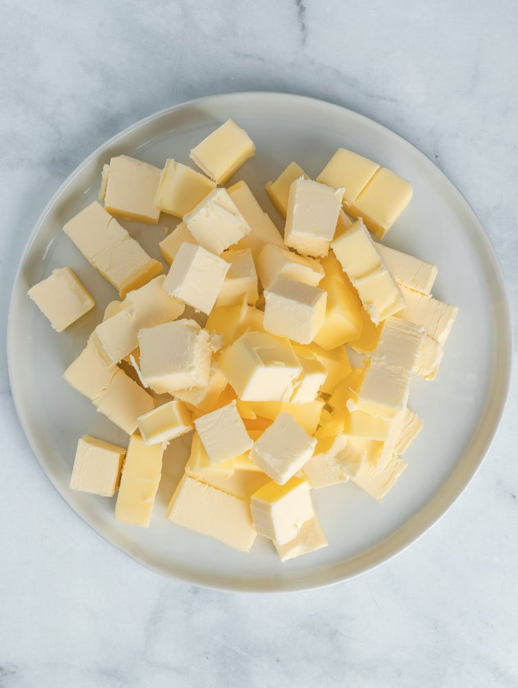 Cubed butter on a plate.
