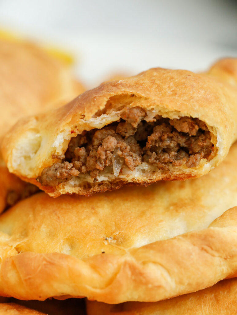 The inside of a baked Lebanese meat pie.