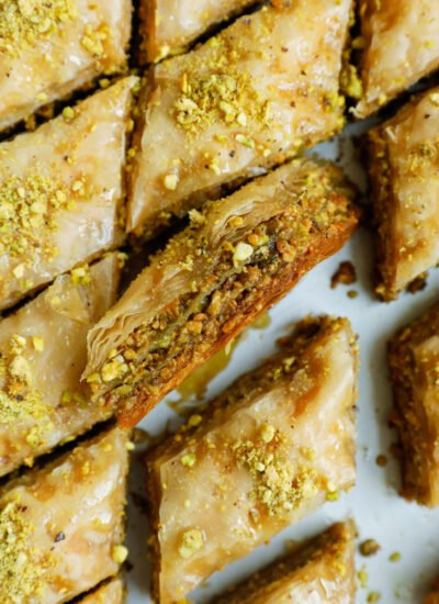 The inside of pistachio baklava, showing the layers of pastry.