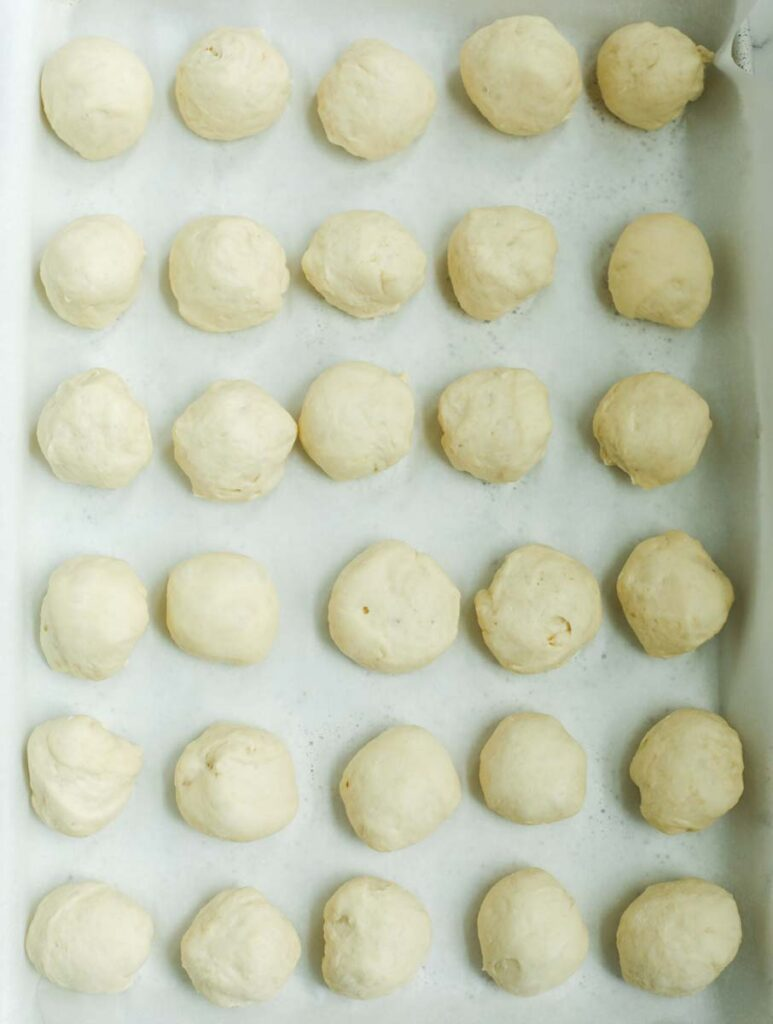 Hand held meat pie dough rolled out into small dough balls.