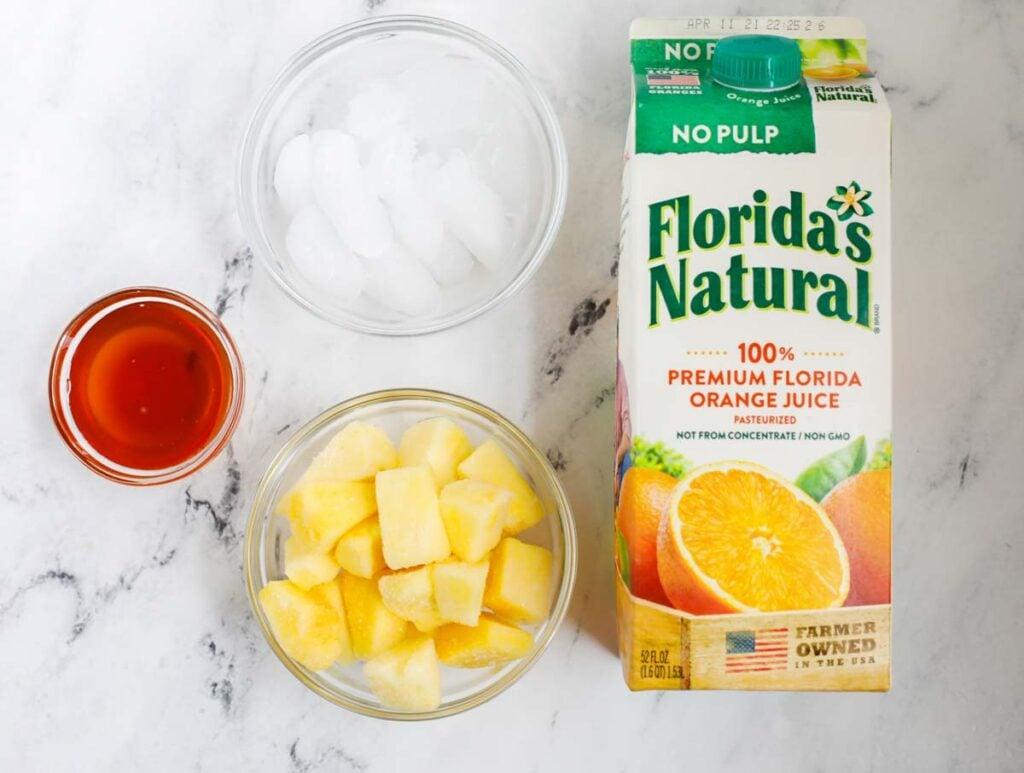 Ingredients needed to make a pineapple slushie.