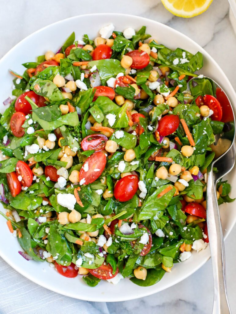 A plate of chickpea and spinach salad.