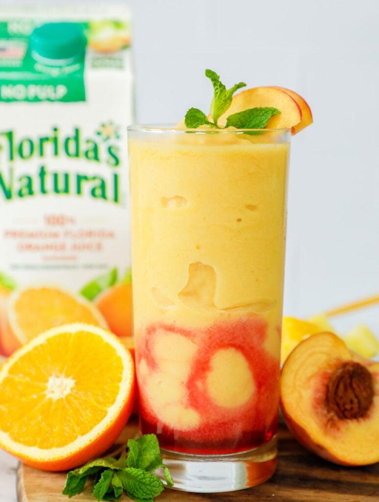 Peach N' Orange slushie in a tall glass.