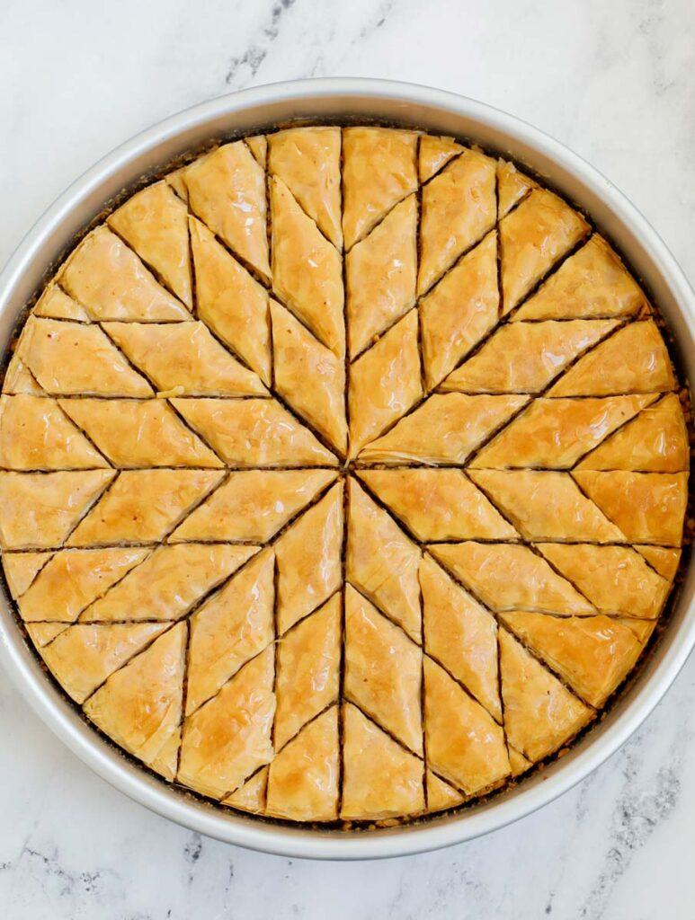 Baked walnut baklava cut into diamond shapes.