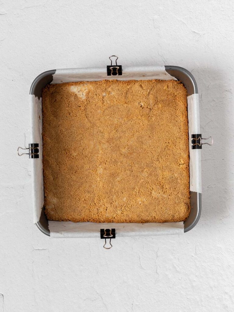 graham crust in a pan after baking
