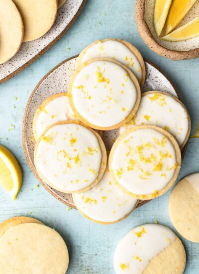 top down shot showing the lemon cookies with icing on a plate with blue background