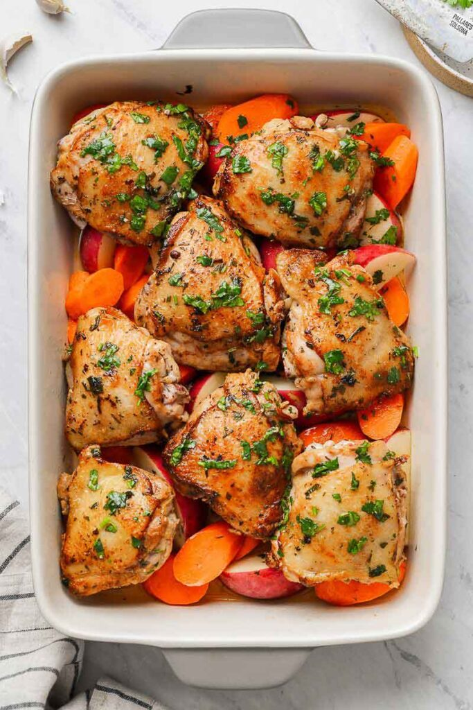 Chicken thighs in a baking dish with veggies