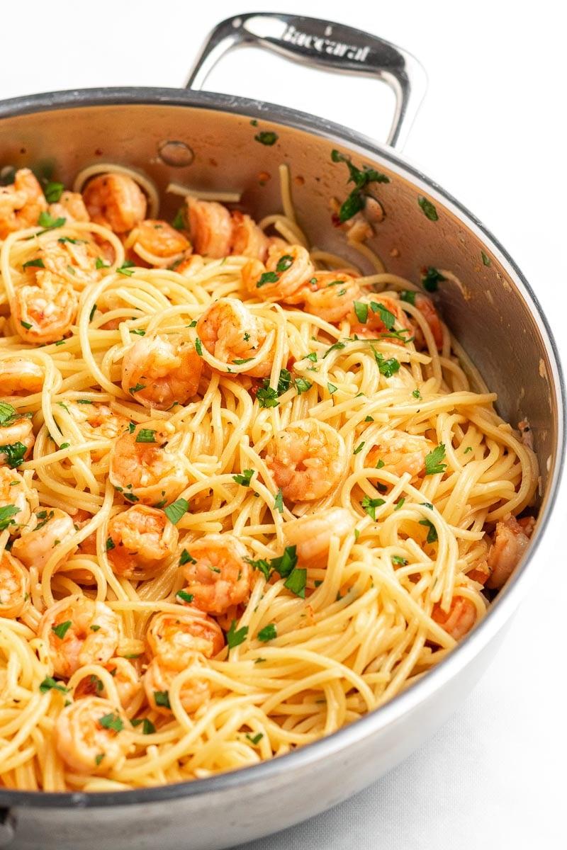 side shot view of shrimp pasta in a skillet
