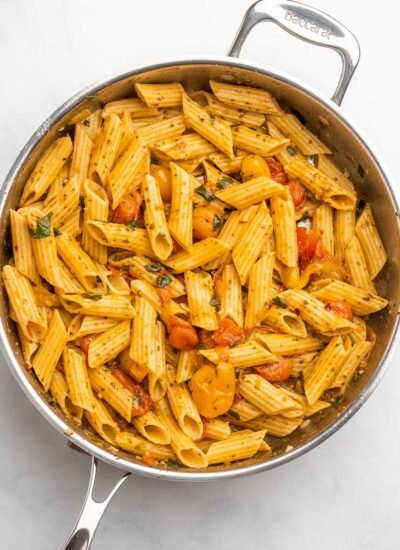 cherry tomato pesto pasta in a skillet
