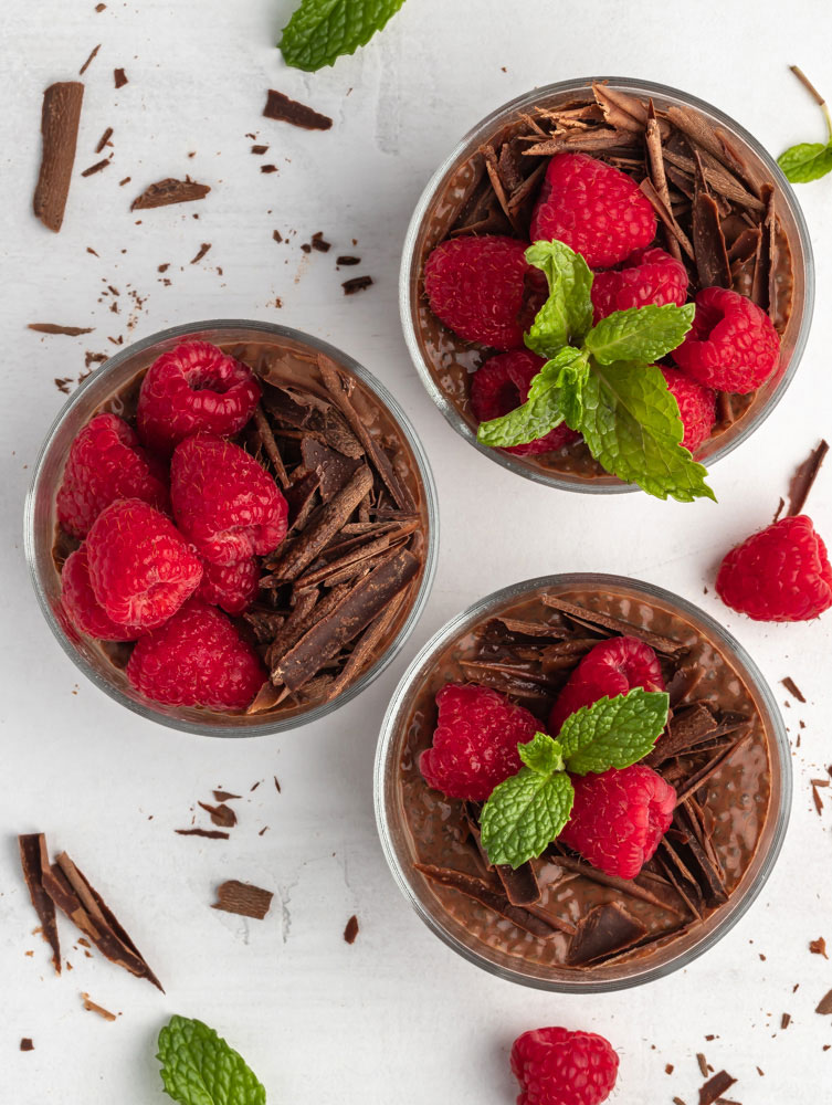 top down shot of 3 chocolate chia pudding cups