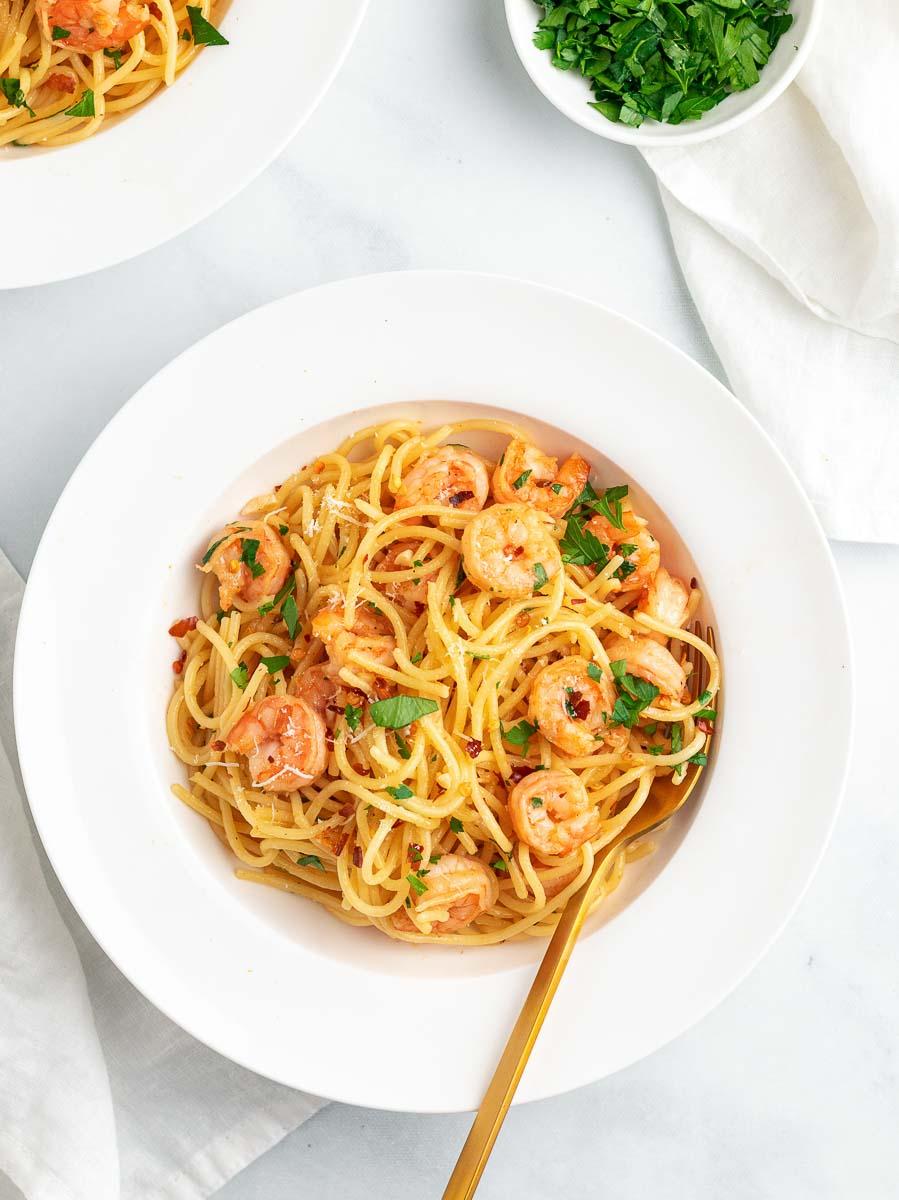 shrimp pasta in a white plate