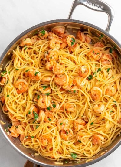 top down shot of shrimp spaghetti in a skillet