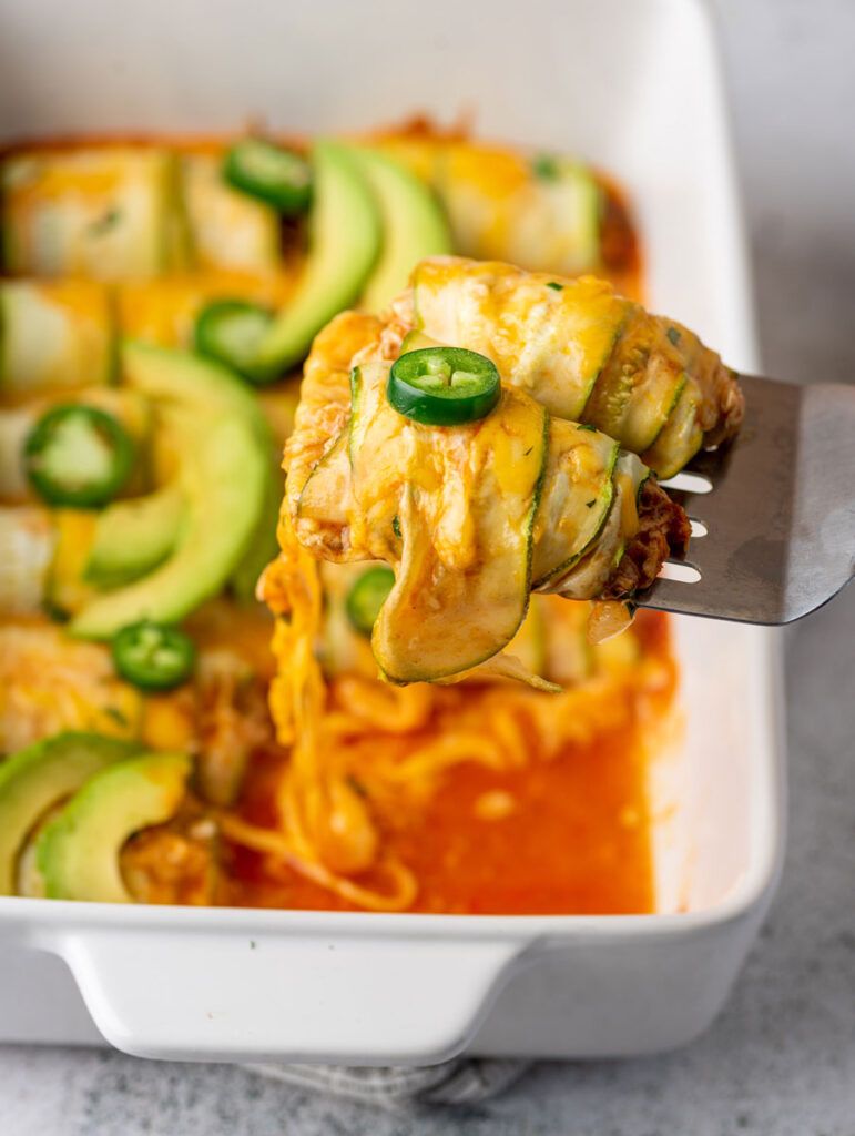 chicken enchilada scooped up with a spoon