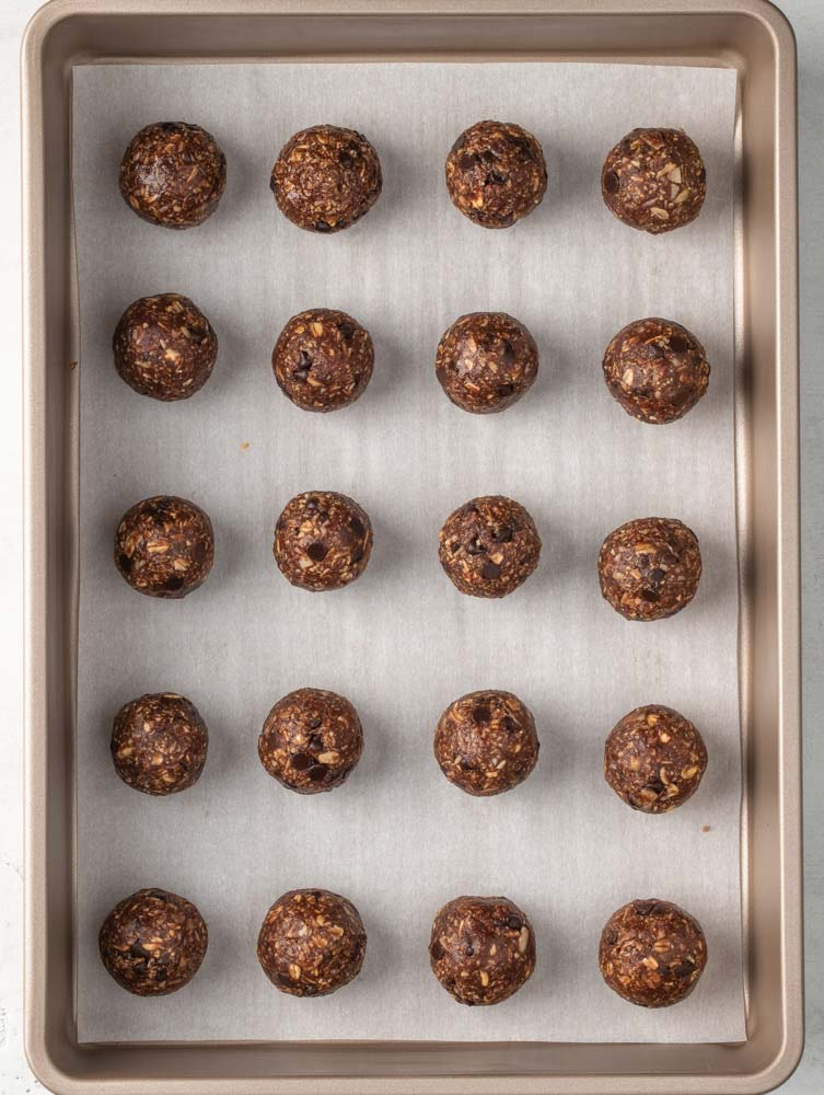 energy balls laid out on a sheet pan for chilling