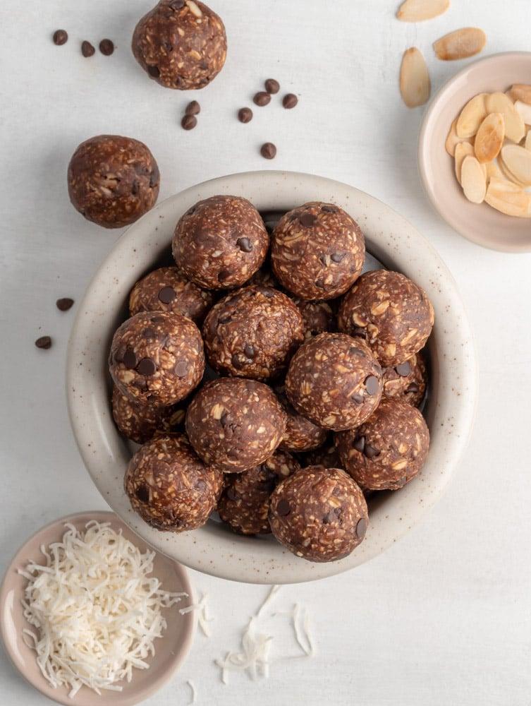 top down shot of almond joy energy balls in a bowl