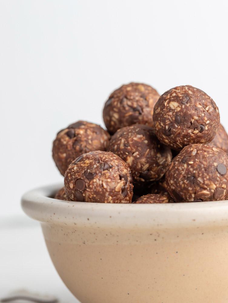 side shot of almond joy energy balls in a bowl