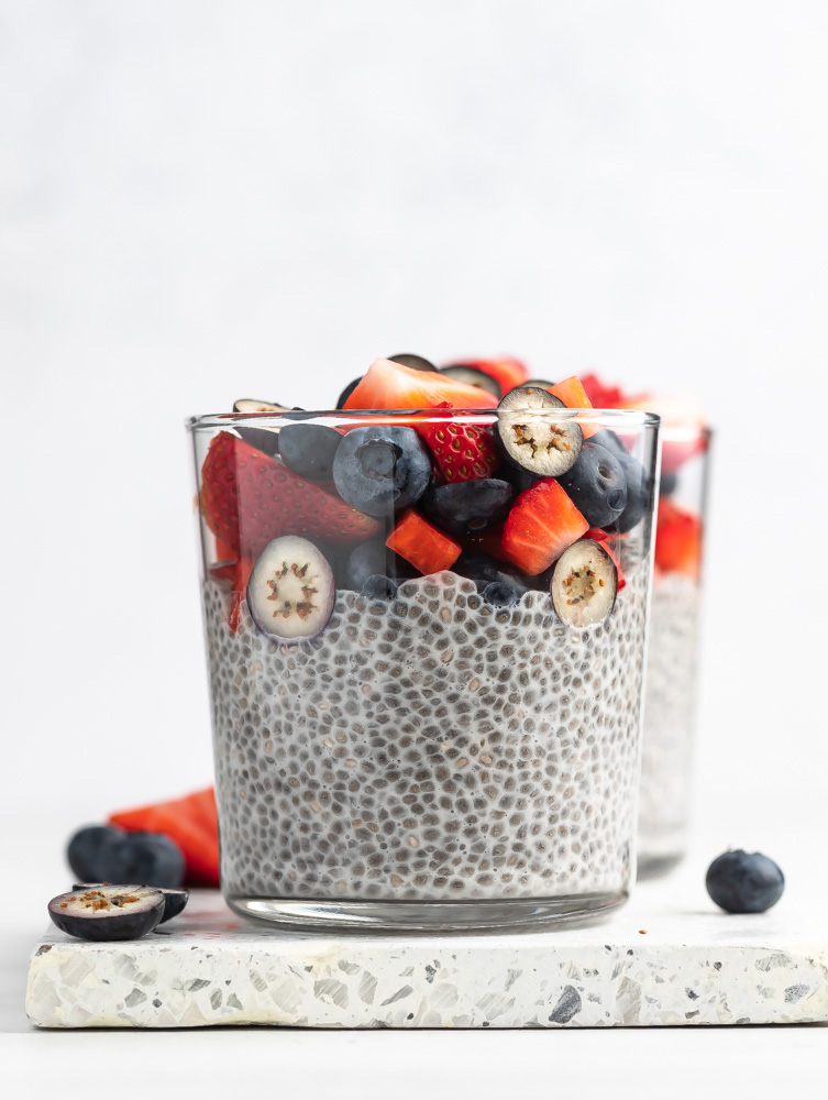 close up shop of chia pudding with berries on top