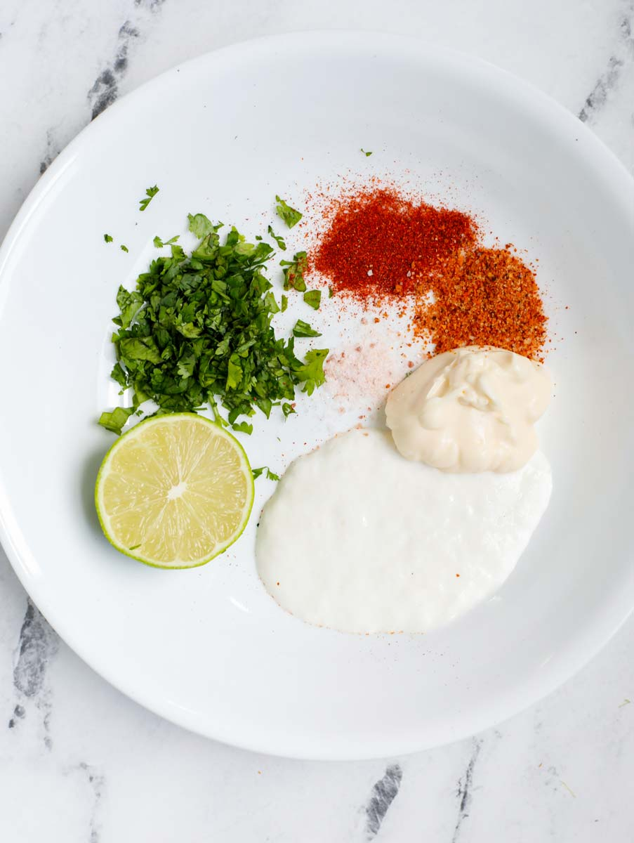 Ingredients for Mexican street corn sauce in a bowl.