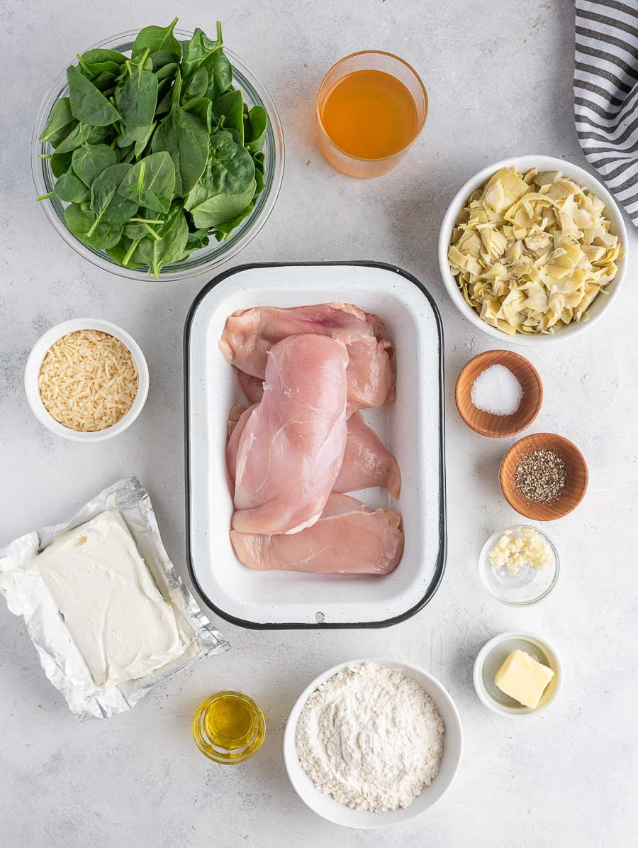 ingredients of spinach artichoke chicken laid out