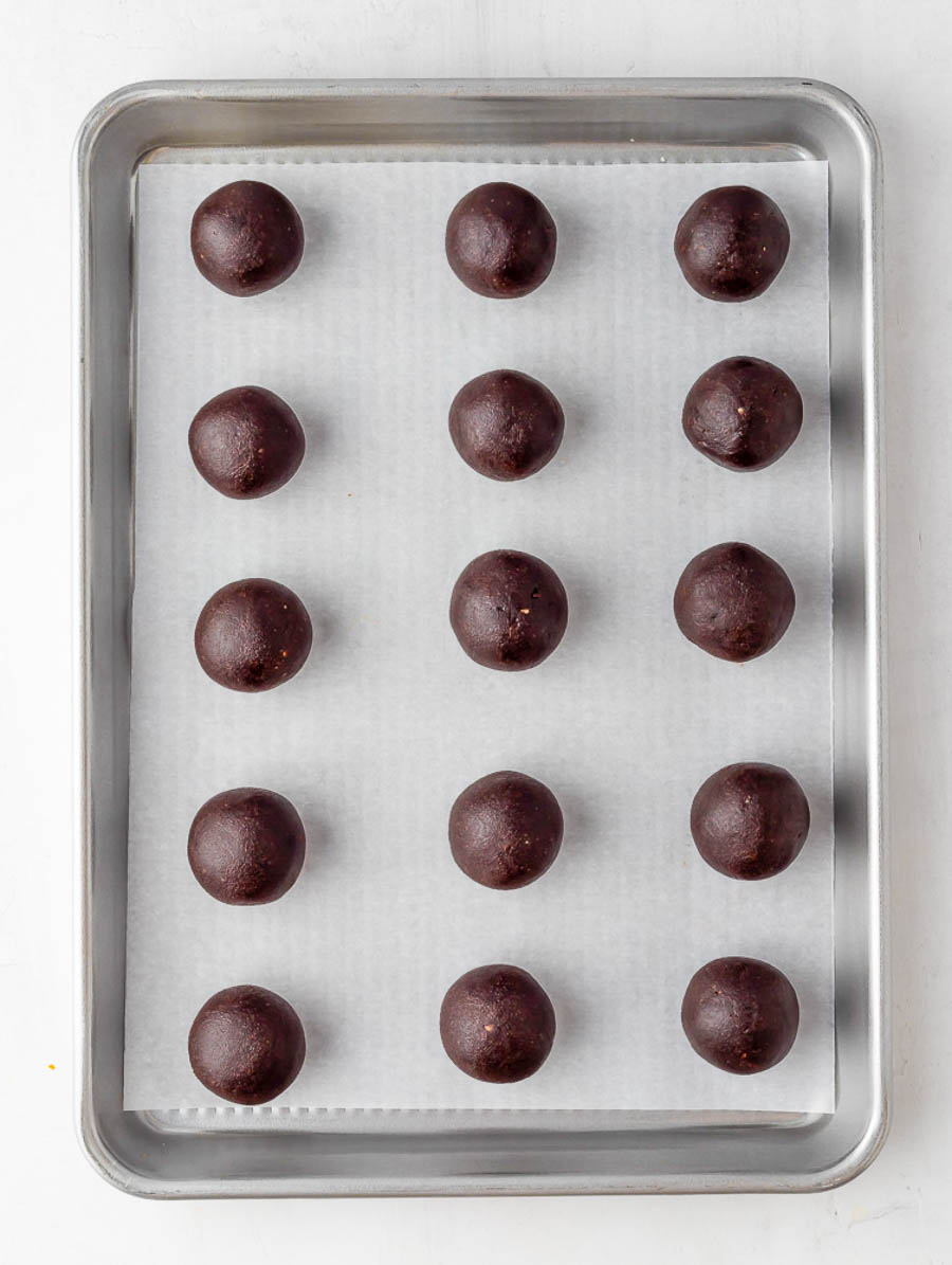 energy bites laid out on a sheet pan to cool