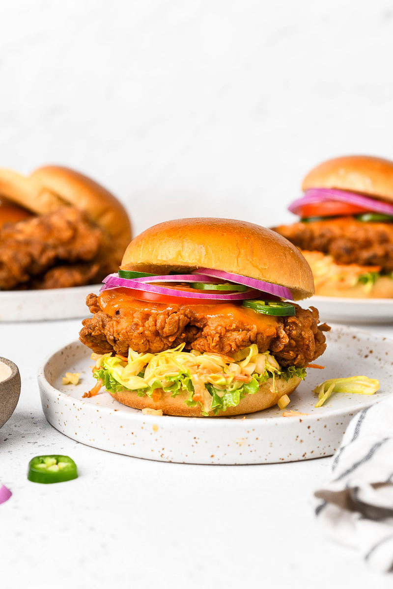 A plate with a fried chicken sandwich.