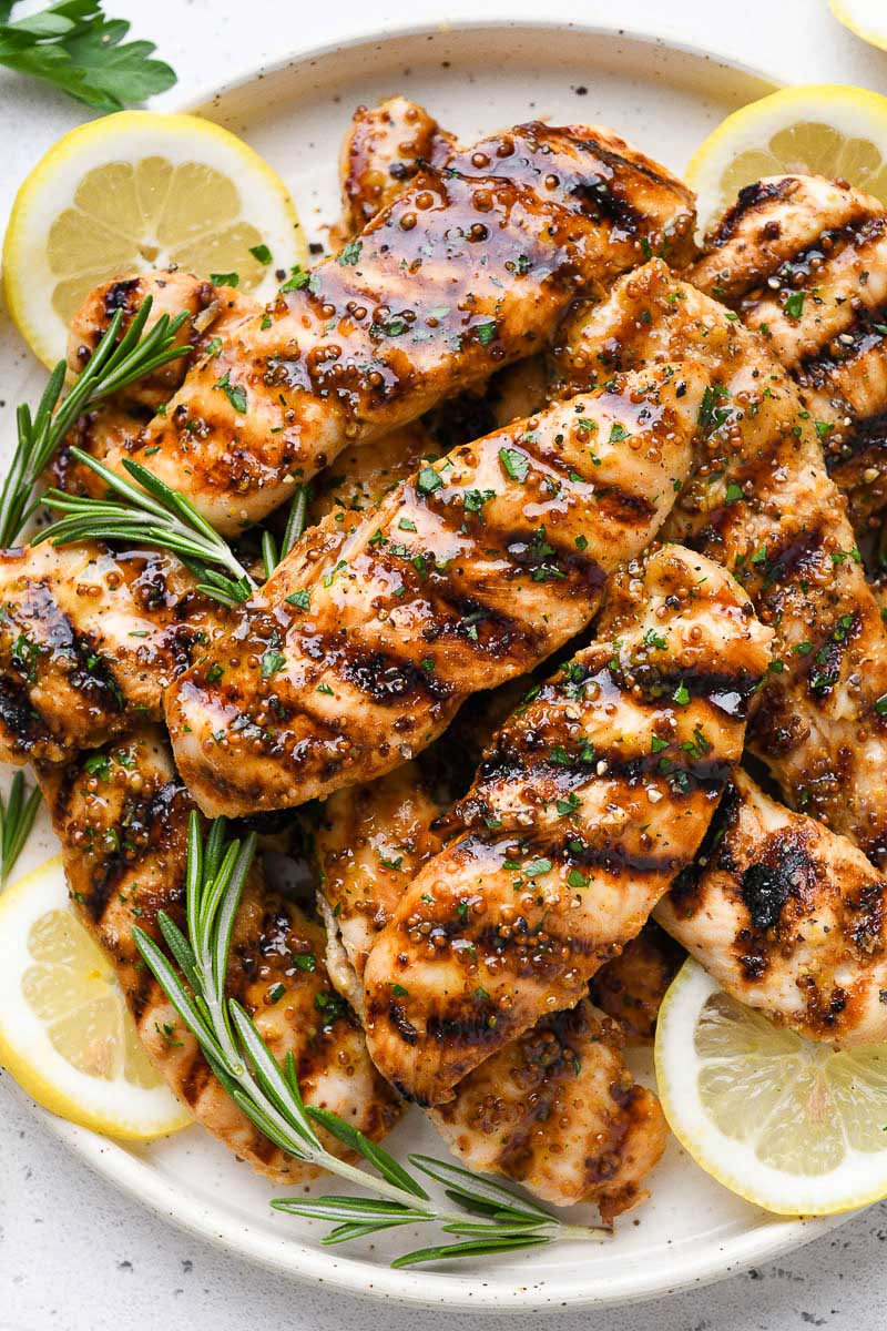 Close up of a plate of grilled honey mustard chicken.