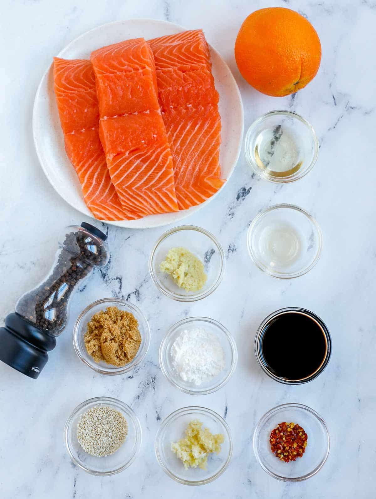 Ingredients needed to make baked teriyaki salmon.