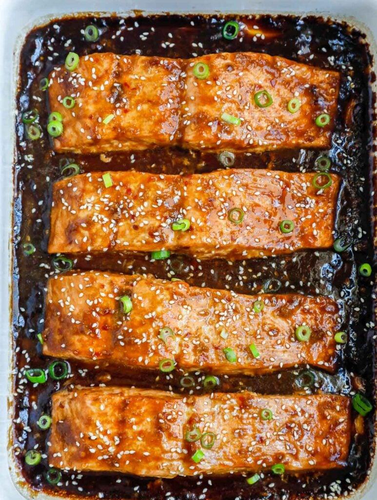 Teriyaki salmon in a baking dish.